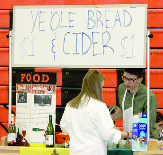 Patrick Day offers cider at a booth during the WHS Renaissance Fair.
