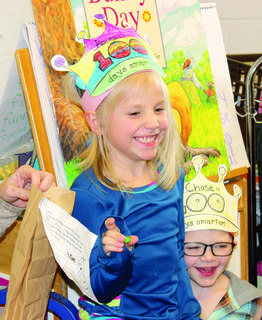 CELEBRATING 100 DAYS OF SCHOOL - Williamstown Elementary kindergartner Abigail Lamson shows off one of the 100 candies she brought in honor of the 100th day of school.   See more 100th Day photos on page 2. Photo by Bryan Marshall