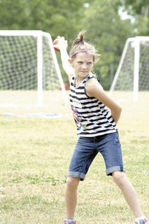 Brianna Murphy winds up to throw while playing bocce ball at Summer Splash camp at Grant County Park in Crittenden.