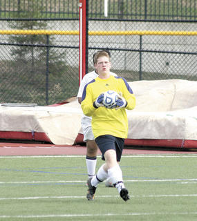Goalkeeper Cole Barnes looks for open teammates after making a save.