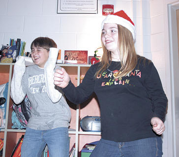 Williamstown Elementary fifth graders Cassandra Ecklar, right, and Alex Ford, left, dance during a play that students wrote and performed for classes before the holiday break.