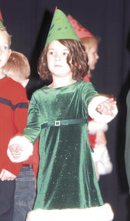 Gracie Button wears a green Christmas dress for the concert.