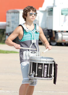 Alex Wyatt mans the drum during the WHS Band of Spirit summer camp.