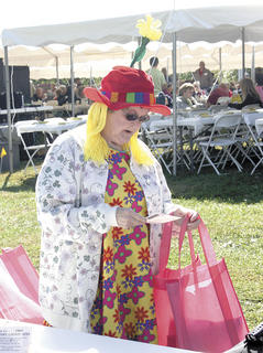 Hilda Webster checks out one of the many goodies she received from local businesses.