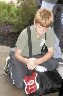 WMS student Collin Krist prays quietly.
