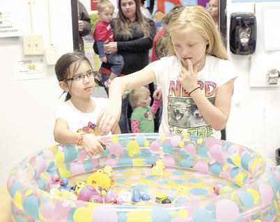 Emily McGee struggles to decide which duck to choose at the duck pond game at CMZ's Fall Fest while Courtney Ruark waits her turn. Photos by Bryan Marshall