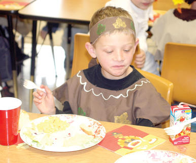Second grader Mason Laurent isn't sure he likes what he's eating.