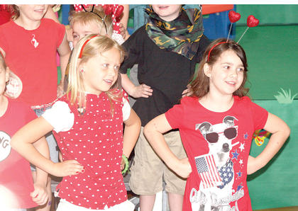Ladybugs Jaylen Hamilton and McKinzie Brumley sing their part in the play.