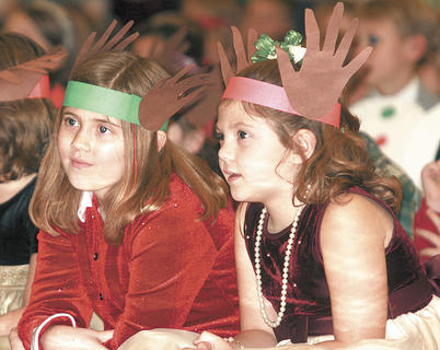 Brent Lee Threlkeld and Lauryn Cleveland wear antlers as they watch the concert.