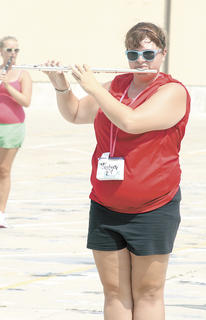 Sydney Kemper wears sunglasses to fight off the sun while practicing at band camp.