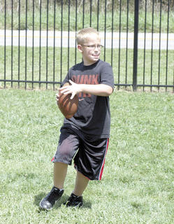 Crittenden-Mt. Zion Elementary fifth grader Alex Smith prepares to launch the football during recess.