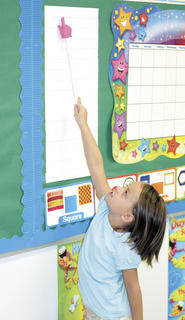 Anna March uses a pointer to show the days of the week on the calendar during Critteden Mt. Zion Elementary Kinder Camp.