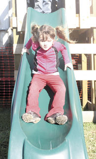 CMZ student Kaylee Crawford is a little unsure of how fast she is going as she heads down the slide.