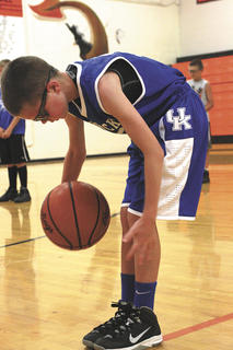 Benjamin Kinsey practices his ball skills as he circles the ball around his legs.