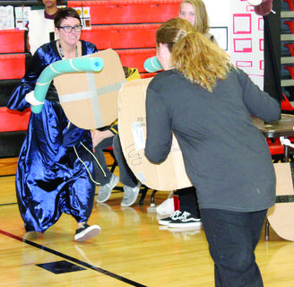 Carrie Mayer, Williamstown High School social studies teacher, jousts with a student.