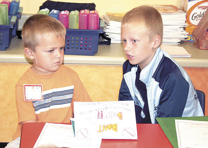 Kindergartener Chaz Surrett listens seriously to Canaan Burch's lesson on bullies.