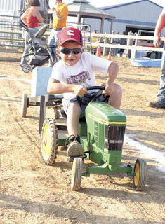 Christian Beach pushes hard during the pedal tractor pull.