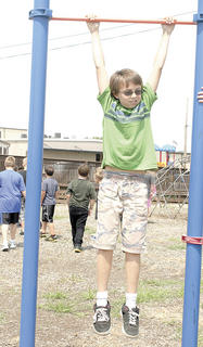 Williamstown Elementary School fifth grader Joey Callahan hangs out during recess while
