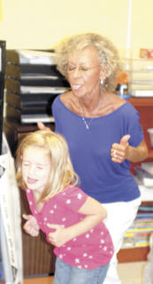 Josie Bates gets her groove on with her grandmother, Monica Schneider at Grandparents day on Sept. 7.