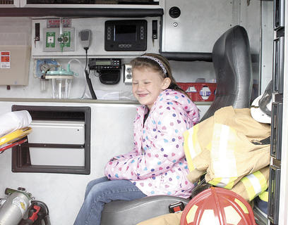 Williamstown Elementary student Leslie Martin checks out the back of an ambulance