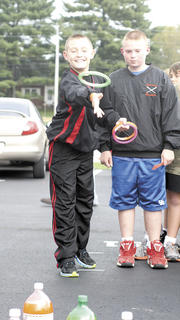  Williamstown Middle School sixth grader Corey Fryman, right, attempts the ring toss.