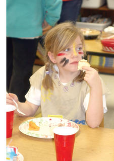 Second grader Phoenix Button eats her Thanksgiving meal. 