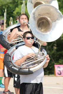 Jordan Jump pretends to play his sousaphone while marching in band camp at WHS.