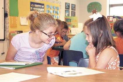 Williamstown Elementary students became teachers when Trish Merritts fifth graders counseled Julie Kinseys kindergarteners on how to cope with school yard bullies.
