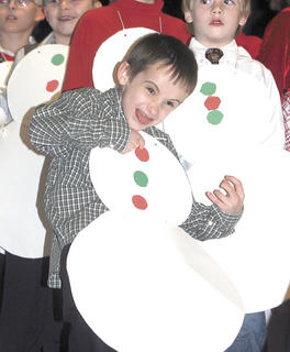 Chase Stewart is not only a snowman, but also an air guitarist during the concert.