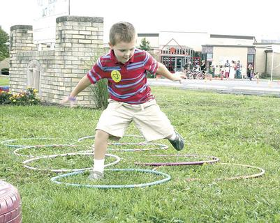 Darius Melton jumps through hula hoops during an obstacle course.