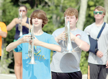 Alex Reynolds prepares to march with his trumpet during the WHS Band of Spirit summer camp.
