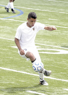 Humberto Valdovinos controls the ball as he looks to turn upfield.