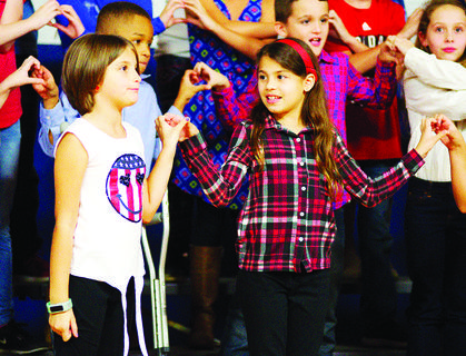 "CMZ students Shanna ""Liz"" Jump and  Anthaydee Rey Estremera perform at the Veteran's Day program held recently."