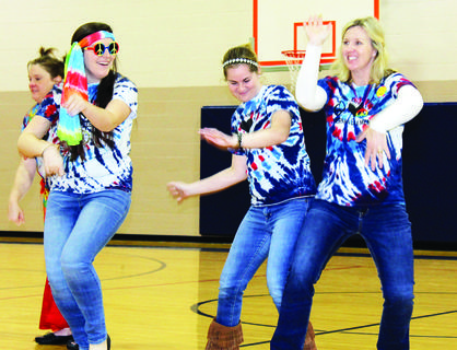 SES staff Brenda Brundage, Abbey Volpenhein, Haley Darnell and Shannon Brickler participate in a dance routine.  Photos by Amanda Kelly, Bryan Marshall and Camille McClanahan