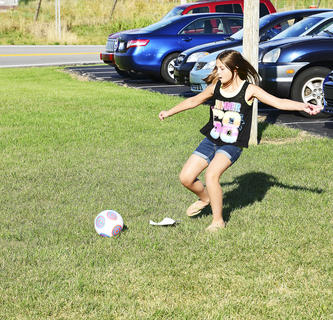 Shelby Woodyard plays kickball.