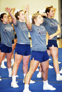 Sydney Bowling, Sara Deaton and Taylor Crisler practice cheer moves.  Photos by Camille McClanahan