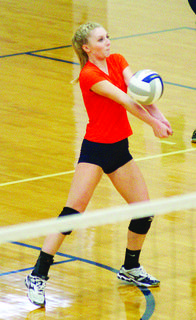 Bry Ezell bumps the ball to a teammate for a set-up against the Owen County Lady Rebels.