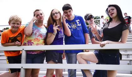 Chris Wagers, Abigail Spears-Davis, Shelby Young, Gage Rayburn and Sabrina Smith all flash the peace sign on their last day as middle schoolers.