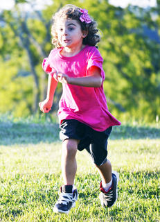 Katlin Muse runs as she plays outside at Lawrenceville Baptist Vacation Bible School.
