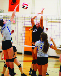 Haley Middleton with the block on the Lady Bearcats.  The Lady Demons fell to the Walton-Verona Lady Bearcats Sept. 5 in three sets (25-15, 25-22, 25-12). Williamstown Lady Demons are on the road Sept. 14 to take on Trimble County.  Photos by Mark Verbeck.