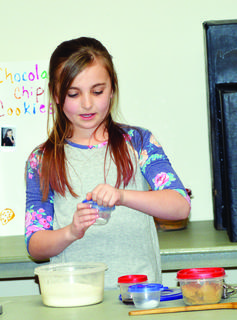 Avery Colson shows how to make a recipe.