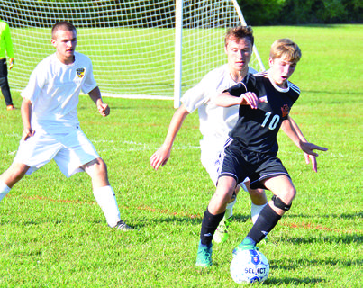 Grant County's Lane Hearn and Hayden Dobbs defend against Williamstown's Brock Houchens. In the Forcht Bank Tournament, Williamstown defeated Holmes 3-0, Grant County beat Holmes in a shootout and Williamstown won the tournament by winning against Grant County in a penalty kick shootout. Photos by Jerry Morris