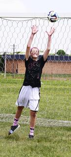 Shelby Aarmeyer attempts to catch the ball during a soccer game.