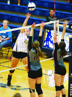 Katrina Byrne with the block on Owen County as teammate Autumn Fryman hangs back as support during the set.