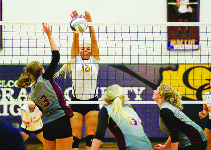 Kacia Smith with the top-notch block for Grant County during their hotly-contested match against the Lady Rebels of Owen County.  The Lady Braves took down Owen County Lady Rebels (28-26, 25-18).  Grant County travels to play Gallatin County Sept. 14. Photos by Mark Verbeck.