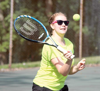 Grant County High School tennis player Mallory Johnson demonstrates how to hit at the net during a Youth Tennis camp at Webb Park. The GCHS team helped to teach the camp.