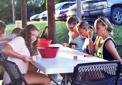 Participants in the sixth to eighth grade missions play a game.