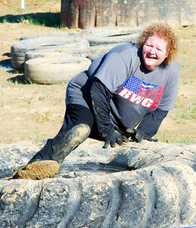 Melanie Wallace conquers an obstacle.