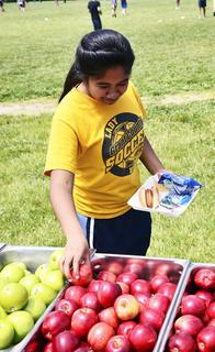 Teana Skilling makes healthy choices by choosing apples as part of her lunch.