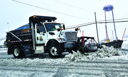A state highway plow truck takes care of Taft Highway in Dry Ridge on March 24. Photo by Mark Verbeck
